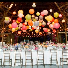 The colorful paper lanterns create a magical atmosphere. It looks like everything is floating.