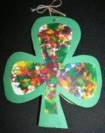 shamrock activities, st. patrick's day activities, march bulletin board ideas, shamrock bulletin boards, st. patrick's day bulletin boards, spring bulletin boards, shamrock crafts, spiral art project, cutting a spiral, spiral template, shamrock templates, melted crayon art,