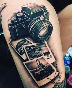 This Polaroid camera is an amazing tattoo idea for travelers who love to take pictures. If you look closely, each photo has a different location ...
