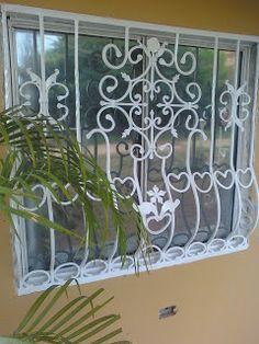 Cercos rejas protecciones de herreria para ventanas for Modelos de portones en hierro forjado