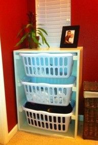 Laundry baskets in an old dresser for easy sorting.