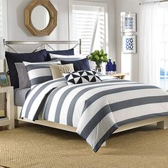 The bold evenly spaced stripes of the Nautica Lawndale Duvet Cover Set offers a breezy look to transcend your sleep space. Crafted of cotton with a yarn-dye stripe design, this duvet cover set has a full enveloping look to give you extra comfort. Navy Comforter, Twin Comforter Sets, Duvet Sets, Duvet Cover Sets, Striped Bedding, Style Nautique, Nautical Bedding, Bed Sets, Pottery Barn