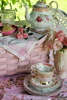 Tea pot and tea cups in pretty pink   painted pink picnic basket