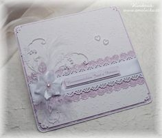 Big lilac wedding card with embossed paper and satin flower.