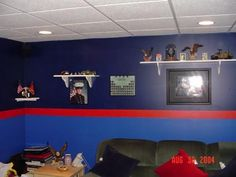 Perez's Marine Corps basement with dress blues walls