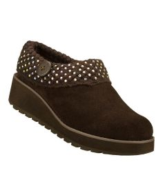 Keep feet out of the cold with this cozy clog. Soft suede keeps feet warm and comfy, while the rubber traction sole ensures a soft and secure step.2'' heel with 1.25'' platformSuede upperRubber soleImported