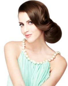 Long straight brunette with a low loose side bun updo, long low sweeping bangs and a deep side part hairstyle