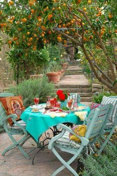 Lynn von Kersting's garden with Indigo Seas French picnic furniture so jealous!