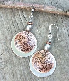 "Hand etched copper discs with a brushed silver disc backing and antiqued silver and copper accents. Very light weight and approx 2"" in length."