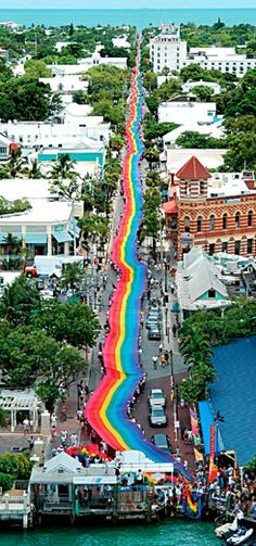Key West - Rainbow Pride Flag Stretched From Gulf of Mexico to Atlantic Ocean Along Duval Street ~ Photo by Andy Newman