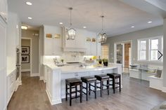 http://www.houzz.com/photos/10183071/Custom-Home-traditional-kitchen-minneapolis  flooring w/ white cabinets