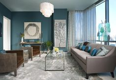 Blue grey room, tall painting for hallway, drum end table.