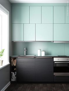 Great kitchen design - sleek cabinets in unique pattern with no handles / pulls.