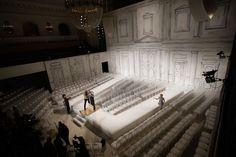 Set from Oscar de la Renta's Spring 2009 fashion show, featuring a trompe l'oeil building facade. Best-Dressed Fashion Show Sets, Architectural Digest.