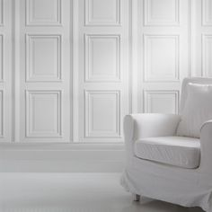 white faux panelling wallpaper by young and battaglia