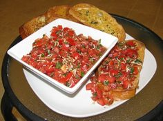 Balsamic Bruschetta...this is sooooo good, easy, and goes great as a topping on chicken laid on a bed of noodles. I am thinking of trying this on a pizza with chicken.
