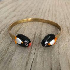 A personal favorite from my Etsy shop https://www.etsy.com/listing/582634332/penguin-brass-bracelet