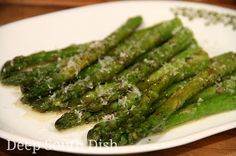 Fresh asparagus prepared by butter steaming in a skillet.