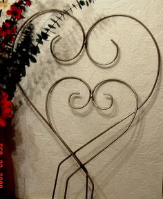TWO Heart Topiary All Metal frames Ivy by SilvertipsIronworks. $19.99, via Etsy.