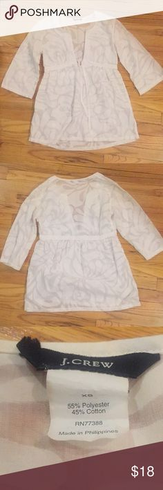 White fun and flirty j crew top!! White patterned v top from j crew!! Size xs! Super flattering with a tie option in the front!   No trades please :) J. Crew Tops Blouses