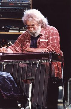 Jerry Garcia on pedal steel guitar. Two things that just rock! Pedal Steel Guitar, Online Guitar Lessons, Slide Guitar, Dead And Company, Forever Grateful, Rockn Roll, Grateful Dead, Concert Posters, Music Stuff