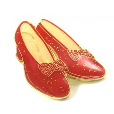 Ruby Slippers pin badge, gold plated detailing with red enamel glitter infill, 70p each.  #pingame #pins #rubyslippers #wizardofoz #design #enamelpins #glittery #pingamestrong