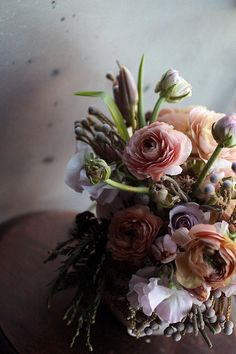 Saipua bouquet arrangement. I like what I think is juniper in this arrangement. Those little balls are delightful!
