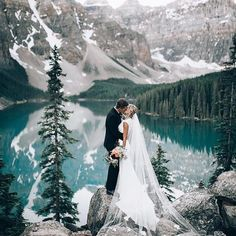 #Repost @weddingforward  Beautiful wedding shot!  Especially in love with the scenic view of Banff Alberta that successfully act as the perfect backdrop to this frame. Who loves this as much as we do? Double tap right away! . . Photo via @wedlist Photo by @dukemoose . . #blog #inspo #weddingday #weddinginspiration #wedding #bride #groom #weddings #couplegoals #engaged #engagement #wedding #bride #bridetobe #weddingdress