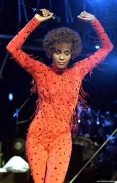 Whitney Houston wearing Marc Bouwer catsuit with hanging bugle beaded fringe details one of the many he created for her during her lifetime