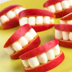 Apple slices, peanut butter on the slices (denture cream), and mini- marshmallows for teeth - how cute is this