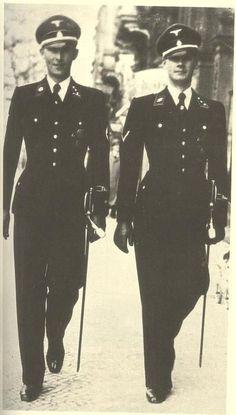 SS uniforms were designed by Hugo Boss , worn here in Paris ... ca. 1940 ...