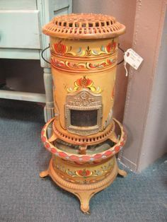 Painted antique room heater. From Vendor 479 in booth 36. Priced at $89.00. Available at The Brass Armadillo Antique Mall - WheatRidge, CO! Shipping available. (303) 403-1677.