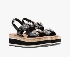Double band sandal with strap Upper embellished with metal studs and flowers Two-tone micro and cord wedge heel 65 mm heel Rubber sawtooth sole