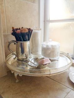 Pin for Later: 17 Real-Girl Secrets to a More Organized Bathroom Vanity A clear jar packed with cotton balls and Q-tips