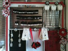 I made a jewelry display from a $10 old window and craft stuff laying around in my studio.  I knocked out 3 cracked panes and carefully sawed off one of the dividers to create the spaces I wanted.  You have necklaces, earrings, braclets, keychains, and even hair accessories acting as decoration on either side.