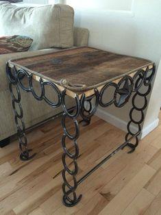 Barn board and horseshoe table. #HorseshoeArt