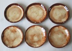 Rustic Dinnerware Plates Deep Red and Gold Salad Plates Set of Six Rustic Tableware Stoneware Dishes Ceramic Dinner Plates Handmade Pottery. $180.00, via Etsy.