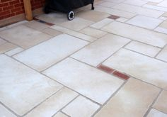 Limestone pavers with polymerized mortar.