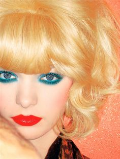 Turquoise eyes and Red lips.