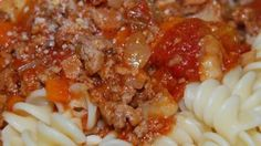 An excellent chunky pasta sauce with beef, pork, lots of vegetables and tons of flavor. Freeze any unused portions for later use. If you have fresh herbs, you may substitute 2 teaspoons chopped fresh basil for the dried basil in this recipe.