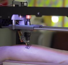 French designers hack a 3D printer to make a tattooing machine.