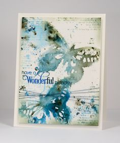 Birthday bister Heather Telford - 'stamp butterfly in distress stains; creates watery imprint; add blue & green bister powder. multiple impressions; left them to dry while I added some texture around the rest of the panel. distress stain on text stamp to add patterns and did some splattering and spritzing with both stains and pearl-ex spray. Once panel was dry added sentiment then trimmed and sponged darker colours around edges.'