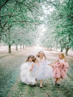 adorable flower girls in pretty pastel dresses | @Mariel Hannah