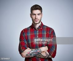 Stock Photo : Young male in check shirt looking direct to camera