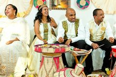 Ethiopian Wedding day two...likng the mesob and the decorations in the back!>>> I'm loving the style of her dress