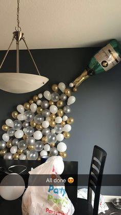 Party idea champagne bottle turned upside down with bubbles pouring out which