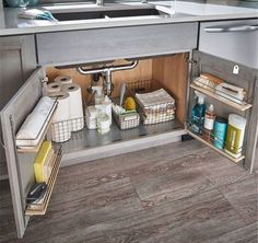 Love this super organized space under the kitchen sink. You no longer have to fear that avalanche of cleaning products!