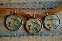 Our Lady of the Eucharist devotional medals created by Kelly Buntin Johnson.