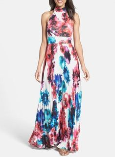 Pretty pleats and floral prints on this halter maxi dress.