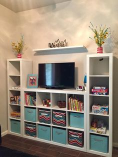 Great for playroom storage minus the tv! Could put books or taller toys there instead The post Great for playroom storage minus the tv! Could put books or taller toys there i appeared first on Children's Room. Kids Bedroom Designs, Playroom Design, Kid Playroom, Organized Playroom, Kids Playroom Ideas Toddlers, Playroom Paint, Kids Playroom Furniture, Den Ideas For Kids, Cheap Playroom Ideas